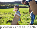 Happy toddler boy playing outside with father in spring nature. 41061782
