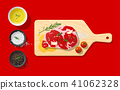 Raw beef steak and seasoning on cutting board 41062328
