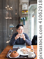 Asian young man drinking coffee 41062918