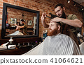 Barber and bearded man in barber shop 41064621