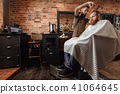 Barber and bearded man in barber shop 41064645
