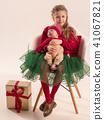 Happy little teen girl holding his newborn baby little sister. Family love. 41067821