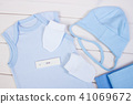 Pregnancy test with positive result and clothing 41069672