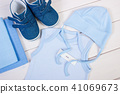 Pregnancy test with positive result and clothing 41069673