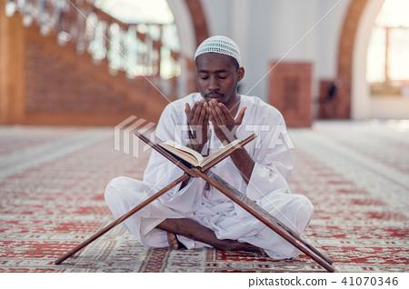 African Muslim Man Making Traditional Prayer To God While Wearing Dishdasha 41070346