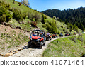 A tour group travels on ATVs and UTVs on the mountains 41071464