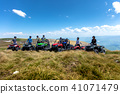 Friends driving off-road with quad bike or ATV and UTV vehicles 41071479