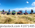 Friends driving off-road with quad bike or ATV and UTV vehicles 41071485