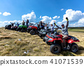 Friends driving off-road with quad bike or ATV and UTV vehicles 41071539