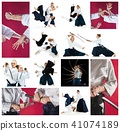 The men and women fighting at Aikido training in martial arts school. Healthy lifestyle and sports 41074189