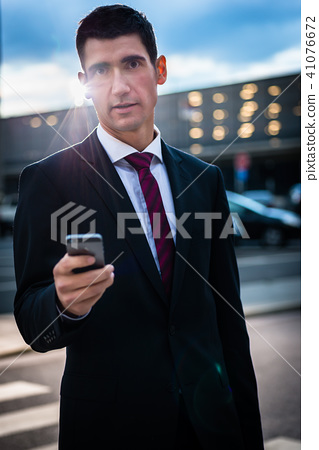 Business man texting on evening outdoors 41076672
