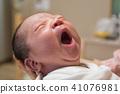 Asian new born baby yawning 41076981