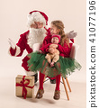 Christmas portrait of cute little newborn baby girl, dressed in christmas clothes, studio shot 41077196