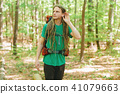 Male hiker listening to something 41079663