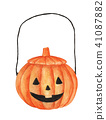 pumpkin basket to collect candy on Halloween 41087882