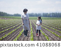 Parent and child working in field work 41088068