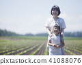 Parent and child working in field work 41088076