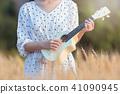 Beautiful asian woman playing ukulele  41090945