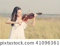 Beautiful Woman standing Playing the violin in 41096361