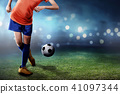 Female football player performing her skill  41097344