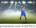 Footballer after winning the match 41097631