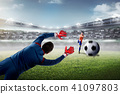 Footballer trying to catch the ball 41097803