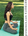 Young girl doing yoga in the park 41098189