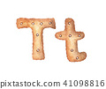 Cookie letter T on white background. 41098816