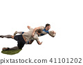 The silhouette of two caucasian rugby man player isolated on white background 41101202