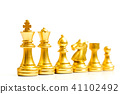 Gold chess piece stand in a row  41102492