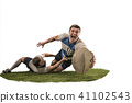 The silhouette of two caucasian rugby man player isolated on white background 41102543