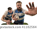 The silhouette of two caucasian rugby man player isolated on white background 41102564