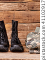 Black combat soldiers boots and clothes. 41102917