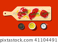 Raw beef steaks on wooden cutting board 41104491