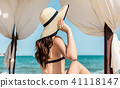 Woman on the beach in sun tent 41118147