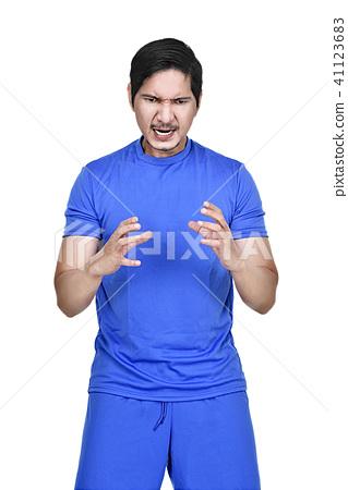 Football player posing like holding the ball 41123683