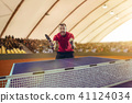 The table tennis player celebrating victory 41124034