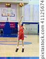 Girl athlete in uniform playing basketball 41125674