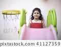 Girl with slide and basketball hoop 41127359