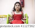 Girl with slide and basketball hoop 41127362