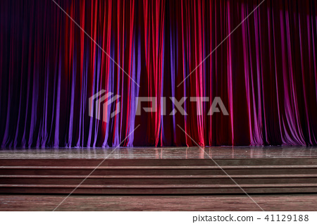 Red curtains and wooden stage. 41129188