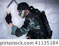 Asian army soldier send special signal to partner. 41135164