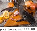 Raw uncooked fish sturgeon at plate before preparing 41137085