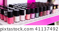 Variety of nail polishes on showcase in cosmetic boutique 41137492