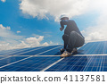engineer team working on replacement solar panel 41137581
