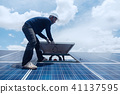 engineer team working on replacement solar panel 41137595