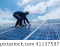 engineer team working on replacement solar panel 41137597