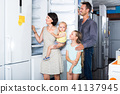 family choosing new fridge 41137945