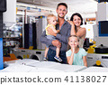 Family with two children shopping 41138027