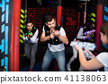 Young man on laser tag arena 41138063